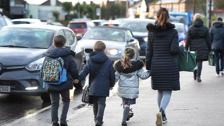 While parents are not allowed to park outside primary schools, the same restrictions do not apply to