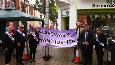 Members of Waveney WASPI with their campaign stall in Lowestoft along with Waveney MP Peter Aldous a