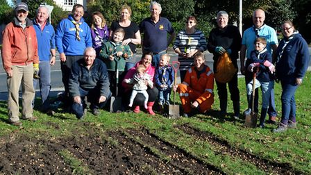 Planting purple crocus corms in Lowestoft as part of the three Lowestoft Rotary clubs nationwide Pur