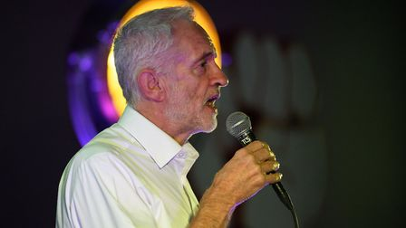 "Labour Party leader Jeremy Corbyn speaks to the audience at a Momentum ""The World Transformed"" event"