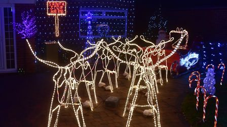 Lee Dowsing and his son Leo have decorated the family home ready for Christmas. The light display is