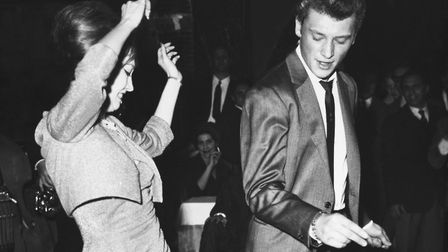 Johnny Hallyday and Valerie Camille dance the twist in Rome, in 1962. Photo: Getty