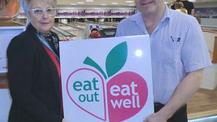 Cllr Mary Rudd with Rob Mayes-Smith, manager at Richardson's Family Bowl. Picture: Waveney District Council.