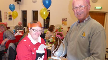 Jenny Dale receiving a trophy from Richard Morling, Waveney Sailability chairman, at the party in D