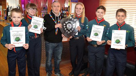 Lowestoft Scouts district commissioner Mel Buck with the successful 4th Lowestoft tenpin bowling team. Picture: MICK HOWES