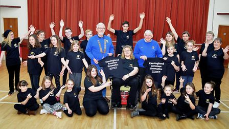 Kessingland Amateur Dramatics club with Lowestoft Lions members after the t-shirts were presented. Pictures: MICK HOWES