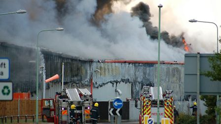BACK THEN: Fire crews battle to contain the blaze at Wessex Foods in July 10. Picture: MICK HOWES