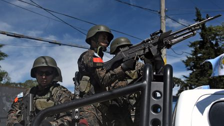 Show of force: Guatemalan soldiers in the capital, Guatemla City. Photo: Johan Ordonez/AZP/Getty Ima