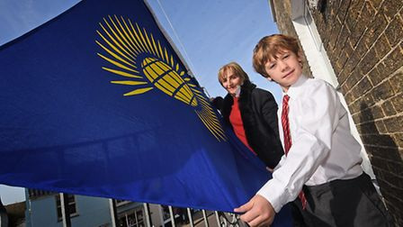 Southwold town mayor Melanie Tucker and Southwold Primary School pupil Oscar Cashell, 9, raise the C