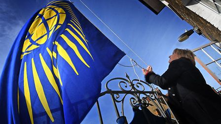 Southwold town mayor Melanie Tucker raises the Commonwealth flag at Southwold Town Hall.Picture: ANT