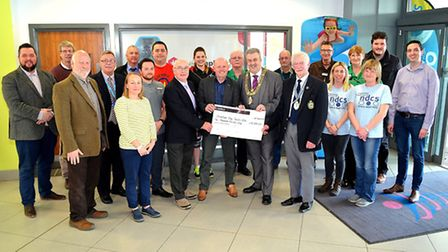 The organisers of Lowestoft's Christmas Day Swim 2016 handed out the proceeds from the event to loca