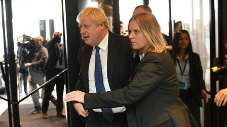 Boris Johnson arrives at the Conservative Party annual conference at the International Convention Ce