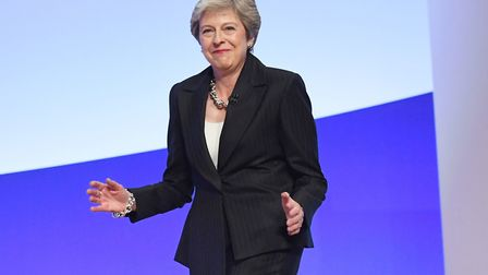 Prime Minister Theresa May dances as she arrives on stage. Photograph: Stefan Rousseau/PA Wire