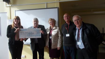 Mac Yallop, Chairman of the Anglia Pensioners Association, presenting a cheque for £1500 to Nicole W