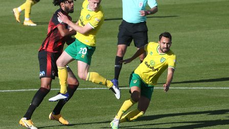 Philip Billing of Bournemouth is crowded out by Oliver Skipp and Lukas Rupp of Norwich Picture: Paul