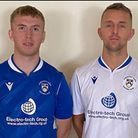 Lowestoft Town's Kieran Higgs and Jake Reed display the new Trawlerboys home and away kits sponsored