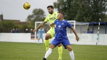 Lowestoft Town's Jake Reed and Hednesford captain Ben Bailey in action at Crown Meadow during the 0-