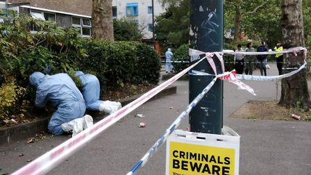 Forensic officers outside an address in an area of London Road, Pollards Hill as police are painstak