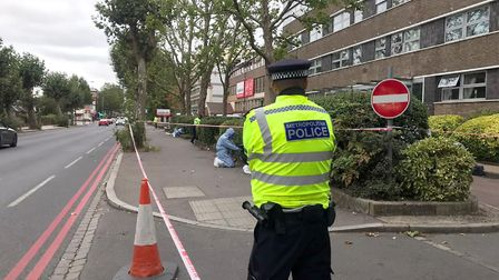Police outside an address in an area of London Road, Pollards Hill as police are painstakingly searc