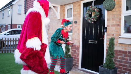 Santa wll knock on the door with his elf to surprise the children Picture: @richardjarmy - www.richa