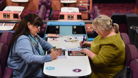 Sue Daniels, left, and Debbie Jeffries play one of the games at the Mecca Bingo. Picture: DENISE BRA