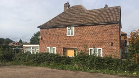 The side of the house on Thunder Lane where Mindaughes Noreika was caught looking after a £60,000 ca