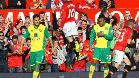Rooney celebrates putting United 1-0 up during a 4-0 Premier League thrashing of Norwich at Old Traf