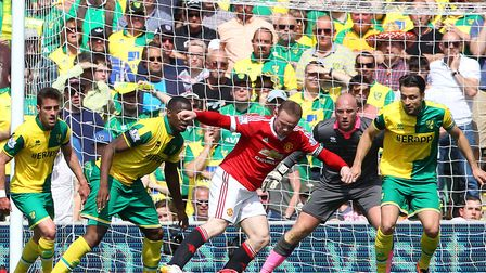 All eyes on Rooney, during his last Carrow Road game, during which he set up the only goal for Juan