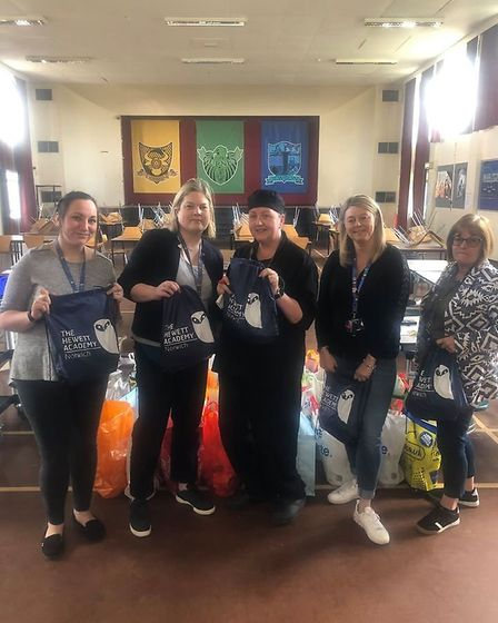 Teachers at Hewett Academy delivering food packages to families during the coronavirus crisis. Pictu