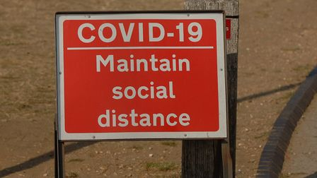 A sign warning people to observe social distancing during the coronavirus pandemic Picture: Chris B