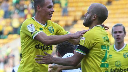 Przemek Placheta, left, and Teemu Pukki scored the goals as Norwich drew their first home Championsh