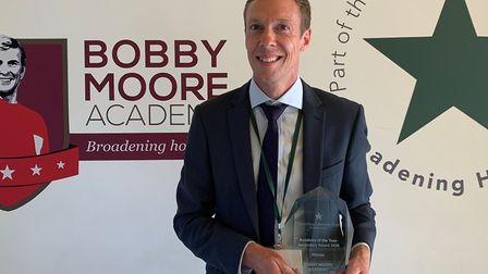 Bobby Moore Academy principal Daniel Botting with the school's award from the David Ross Education T