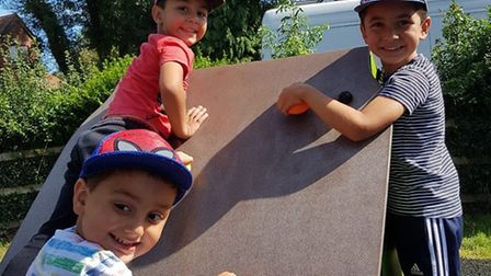 Yaseen, Ebrar and Bilal playing in the park before they were abducted. Picture: Met Police