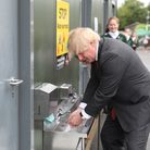 Prime minister Boris Johnson washes his hands on a school visit. Picture. PA Wire/PA Images
