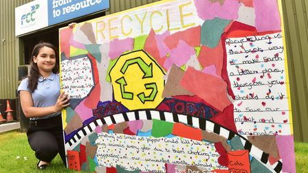 Local school children have taken part in an art competition to design signs to promote recycling. Is