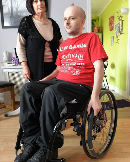 Dean Everet who was attacked in Harold Hill and left paralysed with mother, Patricia. Picture: Rosal