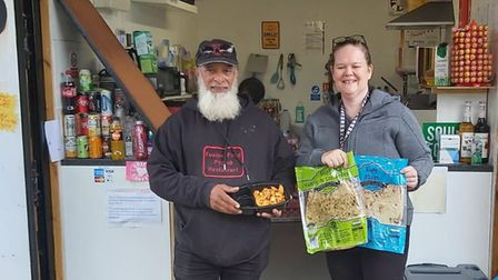 Manzoor Ahmed of Fusion Foods gives meals to Free My Meal Newham volunteer Daniell Hambrook. Picture