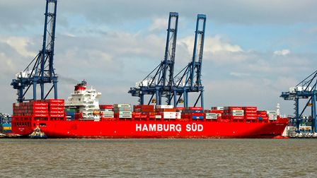 A large, red, container ship at Felixstowe port as seen from Shotley Picture: MICK WEBB