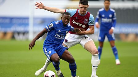 Leicester City's Nampalys Mendy (left) and West Ham United's Declan Rice battle for the ball during