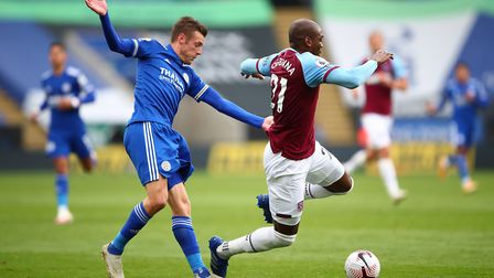 Leicester City's Jamie Vardy (left) and West Ham United's Angelo Ogbonna battle for the ball during