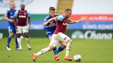 Leicester City's Harvey Barnes (left) and West Ham United's Vladimir Coufal battle for the ball