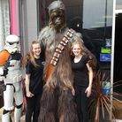 Star Wars themed day in Lowestoft. Coffee Heart staff Claudia and Ellie with Chewbacca
