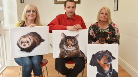 The winners receive their prizes in The Journal's Pets on Parade competition. Left, Nicola Martin wi
