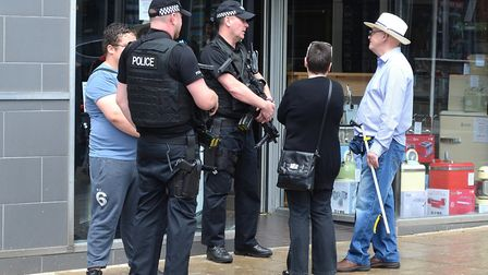 Armed police on patrol, and mingling with the public, in Lowestoft town centre. Pictures: Mick Howes