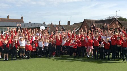 Pupils and staff at Corton Church of England Voluntary Controlled Primary School celebrate their Ofs