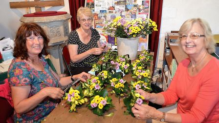 Margaret Cole, Linda Seall, Kath Cottee preparing the floral pew ends arrangements with mini chrysan