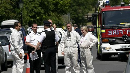 Emergency services at the murder scene in Downshire Hill in June 2006. Picture: Nigel Sutton