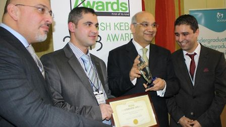 Mustafa Demir (centre left), co-owner of The Best Turkish Kebab in Stoke Newington is presented with