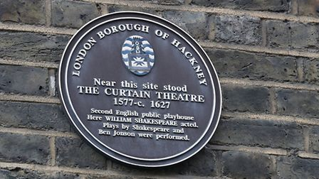 A plaque on Hewett Street noting the siteof The Curtian Theatre