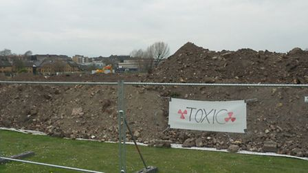The contaminated soil laying uncovered next to the basketball training hall on Leyton Marsh